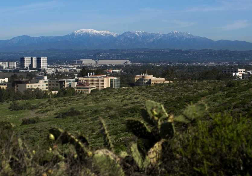 UC Irvine campus with the UC Irvine Ecological Preserve in the foreground and the cities of Irvine and Tustin and the San Gabriel Mountains in the background.  photo:  Steve Zylius/UCI